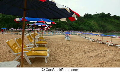 Morning beach - Sun umbrellas and chaise longues on Naiharn...