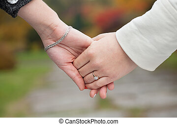 Girls holding hands - Young girls holding hands during...