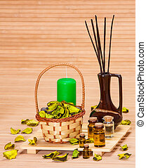 Aromatherapy accessories: floral petals in wicker basket,...