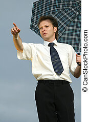man with umbrella pointing with finger