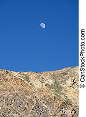 Moon over desert mountains