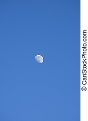 Moon on a blue sky