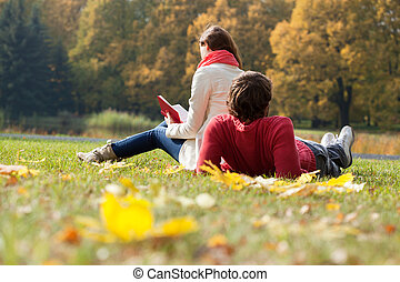 Students spending freetime in the park -