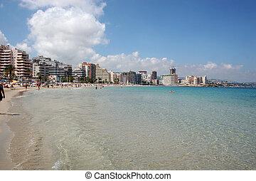 Calpe Beach, Costa Blanca - Summer crowds fill the beach at...