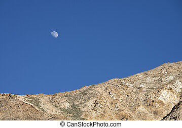 Moon rised over mountains