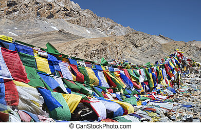 Prayer flags with mountains on background