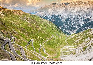 serpentine mountain road in Italian Alps, Stelvio pass,...