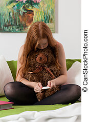 Teenager checks pregnancy test results - Tennage girl checks...