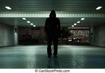 Dangerous man walking at night - View of dangerous man...