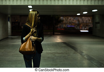 Lonely woman in the underpass - View of lonely woman in the...