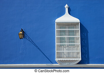 Colourful Trujillo - Bright blue and white Spanish colonial...
