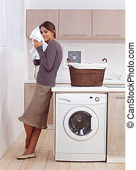enjoys a smell of the washed things - woman enjoys a smell...