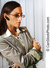 woman with mobile device in ear