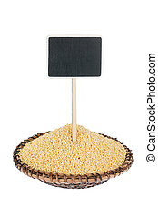 Heap of   millet  in a plate, with a pointer for your text