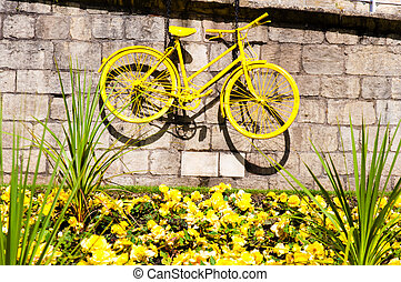 Yellow bicycle exposed on the York city walls as a symbol of...