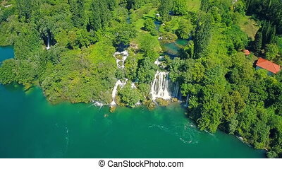 Flying over Roski Slap waterfall - Copter aerial view of the...