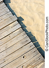 Sandy boardwalk - Weathered wooden boardwalk on sand dune at...