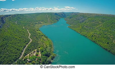 River Krka, aerial shot - Copter aerial view of the river...