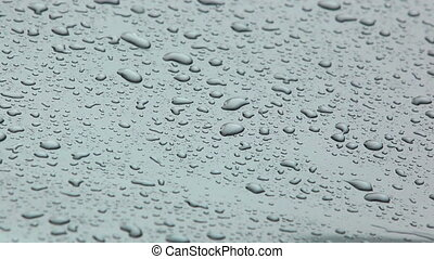 Rain. - Rain on metallic surface.