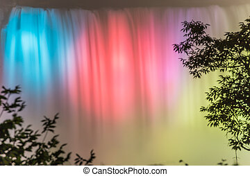 Niagara Falls lit up at night in different colors
