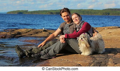 Young tourists couple with dog.