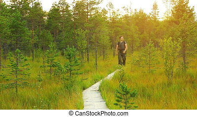 Tourist walking in forest.