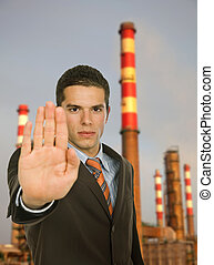 stop pollution - businessman with open hand making stop to...