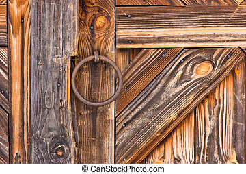 Detail of rustic door - Rustic wooden barn door with metal...