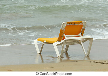 chaise longue by water - yellow chaise longue in water