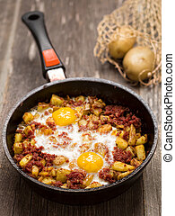 rustic minced corned beef potato hash - close up of rustic...