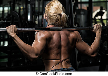 Barbell Squat - Female Bodybuilder Doing Heavy Weight...