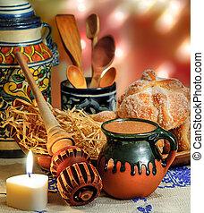 Hot chocolate and sweet bread pan de muerto - Jar of hot...