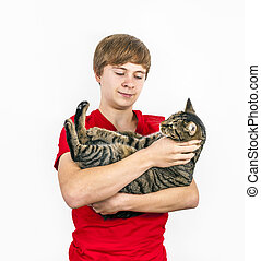 boy hugging with his cute cat - boy hugging with his cute...