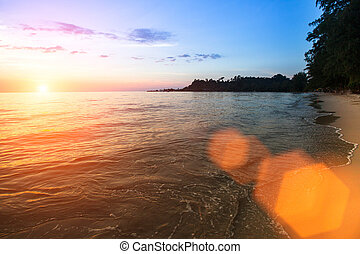 Sea surf on the beach during beautiful sunset.
