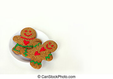 Christmas Gingerbread Man and Woman on Plate Isolated