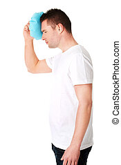 Man with ice bag for headaches