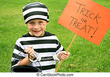 Young Child Dressed in Halloween Costume Trick-or-Treating -...