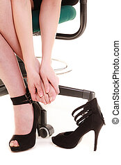 Work stoppage Tired businesswoman taking shoes off - Work...
