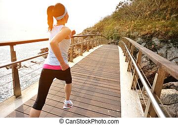 Runner athlete running on boardwalk - Runner athlete running...