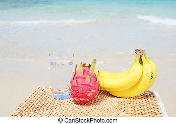 Tropical fruits on the sandy beach