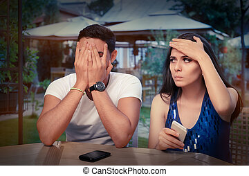 Young Couple Having Problems - Young adult couple with smart...