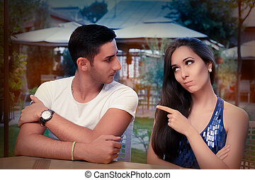 Cute Young Couple Arguing - Young adult couple arguing with...