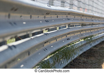 Motorsport Crash Barrier - Metal crash barrier at a...