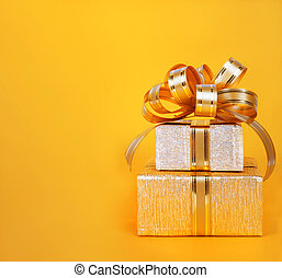 Beautiful Gift box in gold wrapping paper on abstract...
