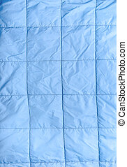 Closeup of blue silk quilted fabric as a background