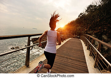 Runner athlete running on boardwalk - Runner athlete running...