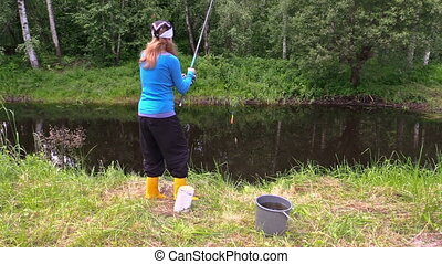 girl catch fish cat pond - blond woman angler catch small...