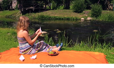 girl make boat stream - young woman make small paper boat...