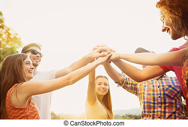 Friends with hands in stack - Group of young people with...