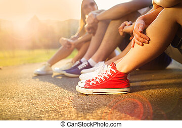 Sneakers of teenage boys and girls - Legs and sneakers of...